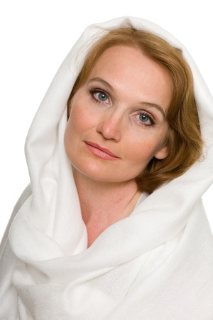 Portrait of beautiful middle aged woman in a white headscarf. Stock Photo - 10556382