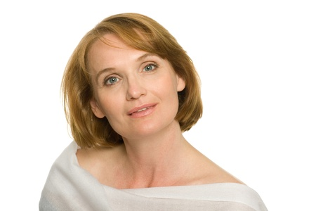 middle age woman: Smiling mature woman in white.