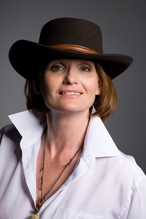 Beautiful middle aged woman in a hat. photo