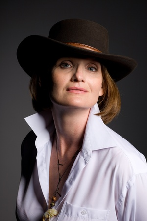 Beautiful mature woman in a cowboy hat. photo