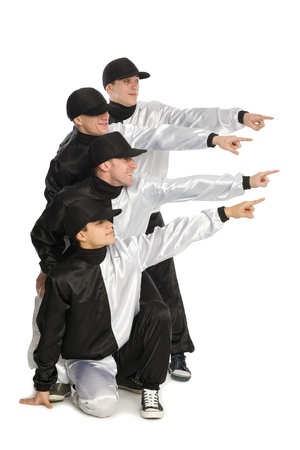Team of guys pointing his hands to the side. Isolated on white. photo