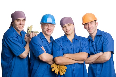 A friendly young team of construction workers. Isolated on white. photo