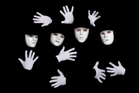 Portrait of a team of young break dancers in masks on a black background. photo