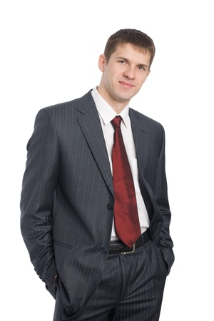 Portrait of handsome smiling young businessman. Isolated on white. photo