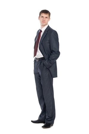 Handsome young businessman with a slight smile on his face. photo