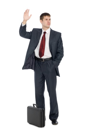 Handsome young businessman with a welcoming gesture. Isolated on white. Stock Photo - 10556234