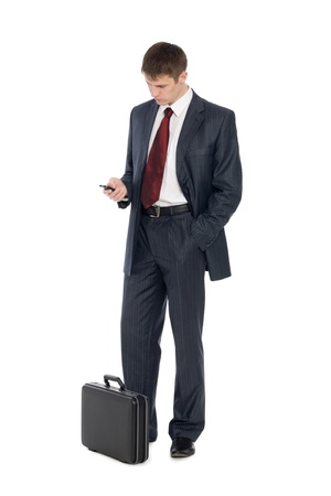 Awaiting a handsome young businessman with a mobile phone. Stock Photo - 10556228