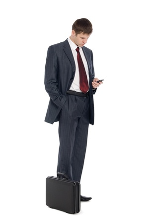 Awaiting a handsome young businessman with a mobile phone. Stock Photo - 10556227