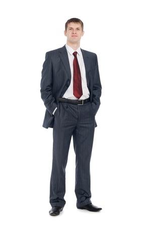 traje: Empresario joven guapo con una leve sonrisa en su rostro.