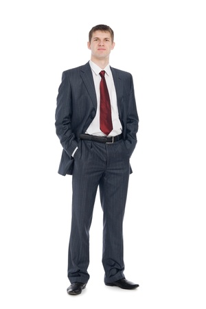 Handsome young businessman with a slight smile on his face.