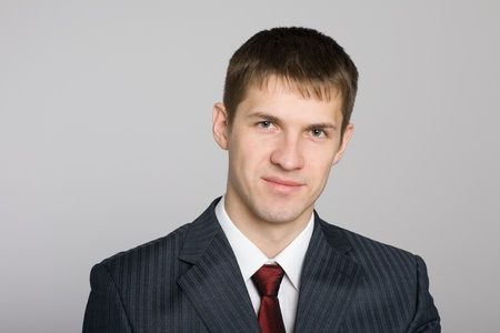 Portrait of handsome smiling young businessman.  photo
