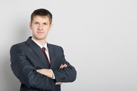 Portrait of a handsome smiling young businessman. photo