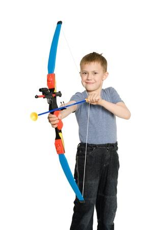 Niño sonriente con un arco de deportes para los niños. Foto de archivo - 10573936