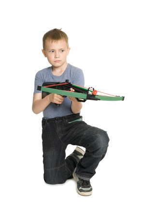 crossbow: Blonde boy shooting a crossbow for children.