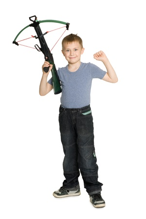 crossbow: Joyful boy holding a crossbow for children.