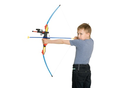 bowman: Blonde boy shoot from the crossbow for children. Stock Photo