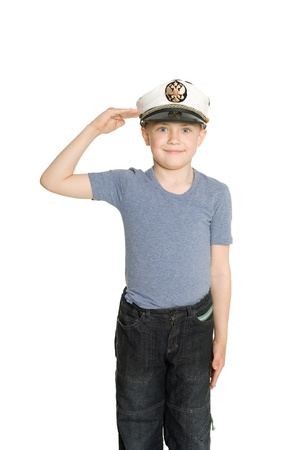 salutes: Boy in the sea cap salutes. On his cap emblem of Russia. Stock Photo