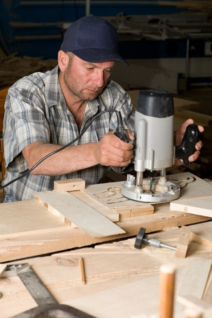 wood turning: Carpenter working in the woodworking shop.