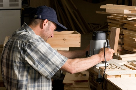 Carpenter working in the woodworking shop. photo