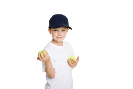Smiling boy with tennis balls. Isolated on white. Stock Photo - 10573053