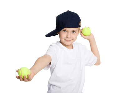 Boy throwing tennis balls. Isolation on white. photo