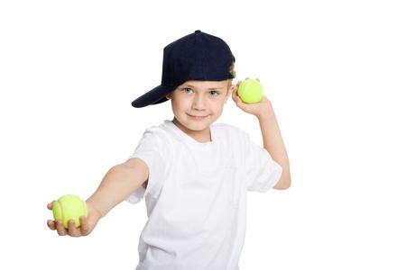 Boy throwing tennis balls. Isolation on white. photo