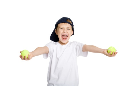 Screaming boy with tennis balls. photo
