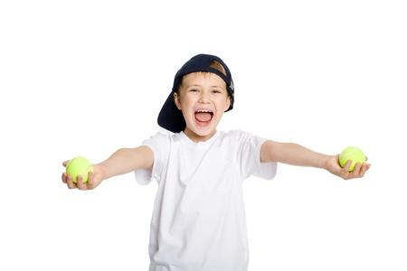 Screaming boy with tennis balls. photo