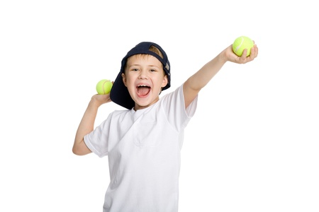 Screaming boy with tennis balls. Isolated on white. photo