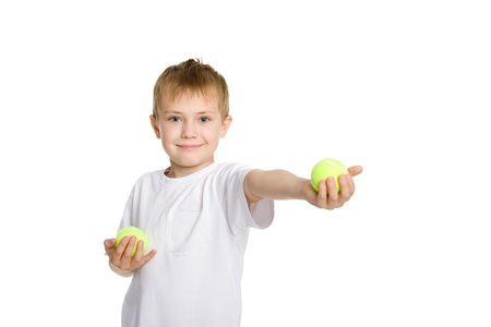Blond boy playing in the tennis balls. Stock Photo - 10573067
