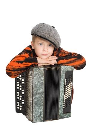 accordion: Boy wearing a cap with accordion. Stock Photo