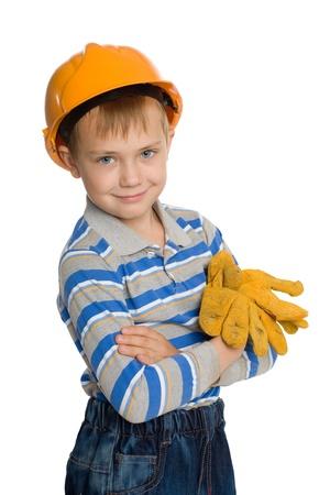 Joyful boy in the construction helmet and gloves. photo