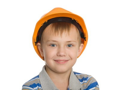 Smiling boy in the construction helmet. photo