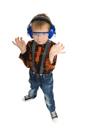 Boy with headphones and glasses listening to music. photo