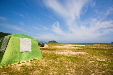 Tent camp on the seashore. photo