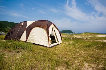 Tourist tent city on the seashore. photo