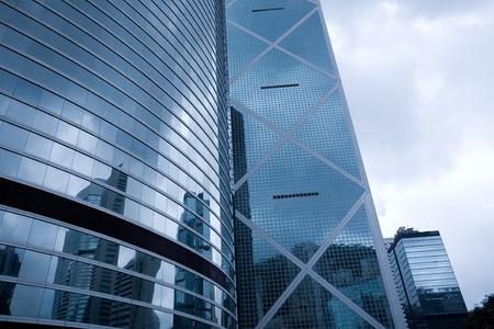 property development: Modern office building in downtown Hong Kong. The evening.