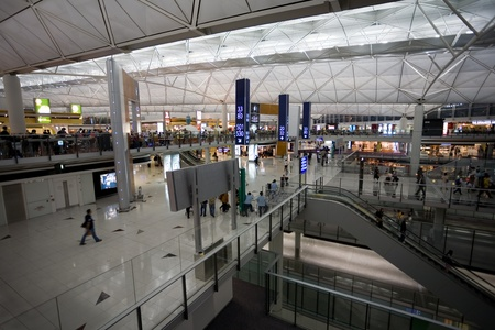 HONG KONG - OCTOBER 5: Hall of Terminal International Airport (Chek Lap Kok Airport) in the evening on October 5, 2011 in Hong Kong. Stock Photo - 11200870