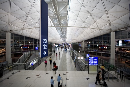 HONG KONG - OCTOBER 5: Hall of Terminal International Airport (Chek Lap Kok Airport) in the evening on October 5, 2011 in Hong Kong. Editorial