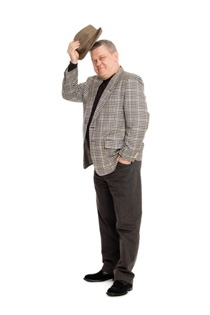 An elegant man in greeting takes off his hat. Stock Photo - 11720608
