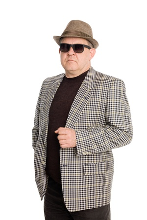 An elegant man in a hat and sunglasses. Stock Photo - 11720639