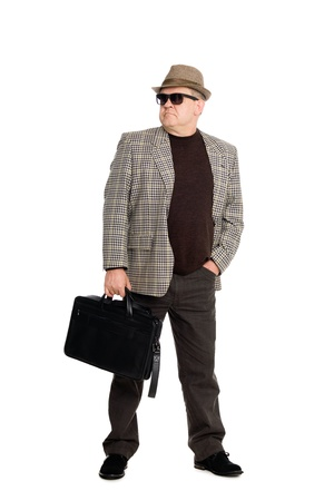 Stylish middle aged man wearing sunglasses with a briefcase. photo