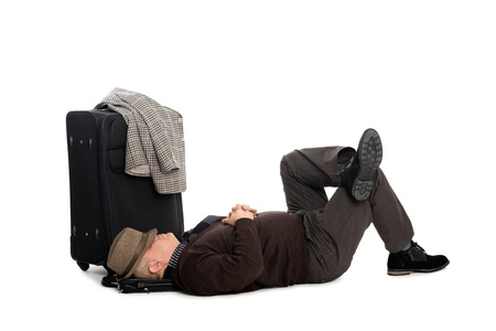 weariness: Tired man in anticipation of landing the plane lying on the floor. Stock Photo