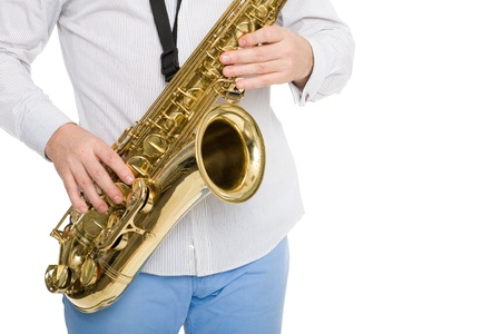 Hands musician playing the saxophone. Isolated on white. photo