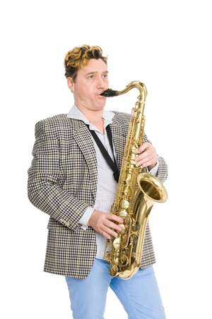 A young man playing the saxophone. photo