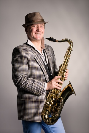 Portrait of a smiling young man with a saxophone. photo