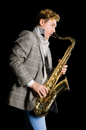 Young man playing the saxophone. photo