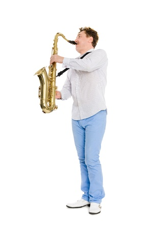 Young musician plays the saxophone. Isolated on white. photo