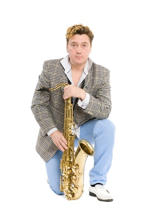 Portrait of a young man with a saxophone. Isolated on white. photo