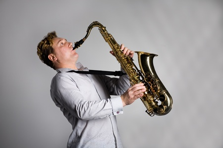 saxophonist: Young musician plays the saxophone. Stock Photo